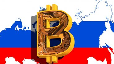 bitcoin logo in front of russia map and flag