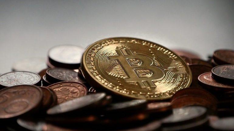 phisycal bitcoin on top of pennies