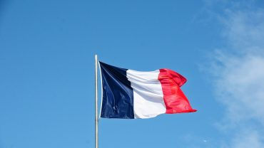 French flag with crypto news