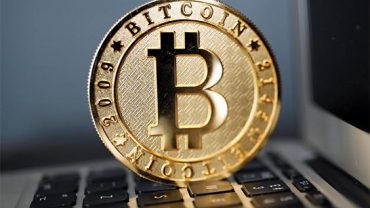 bitcoin in gold on keyboard