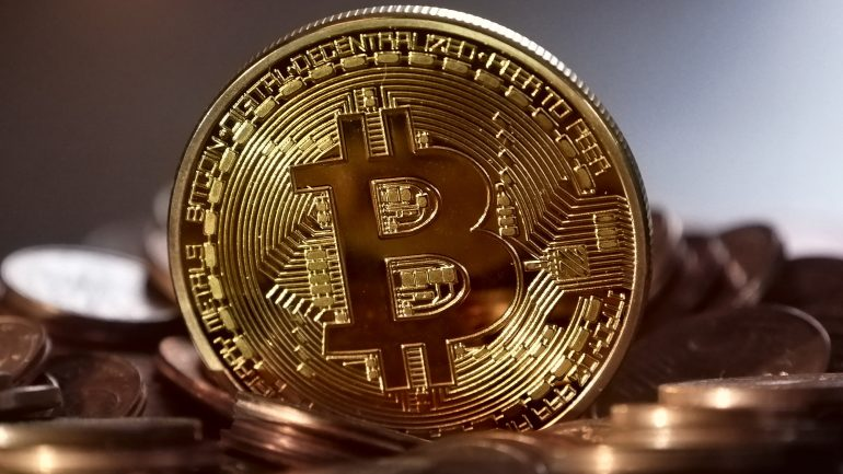 golden bitcoin above pennies