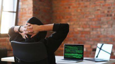 Hacker looking at Bitcoin code