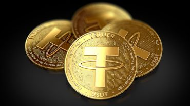 tether coins stacked in gold