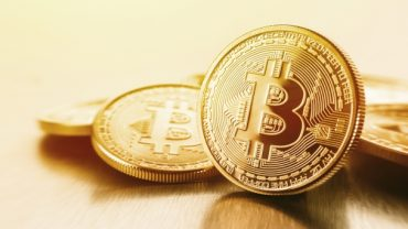 Bitcoin gold coins in currency