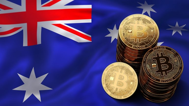 phisycal bitcoins stacked above australia flag