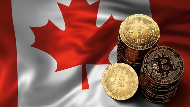 phisycal bitcoins stacked above canada flag
