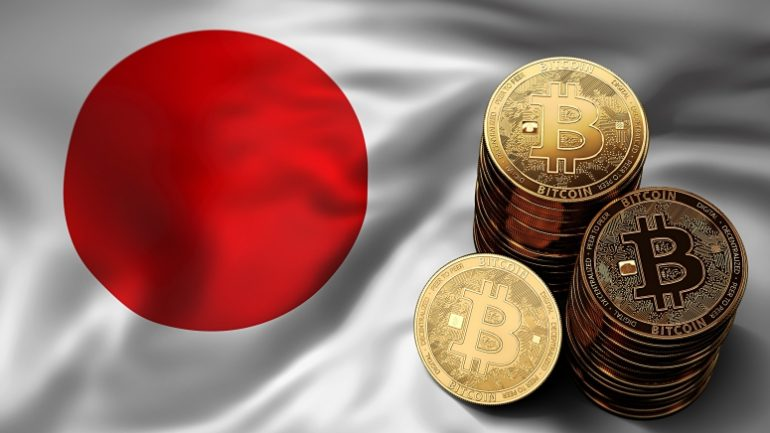 phisycal bitcoins stacked above japan flag