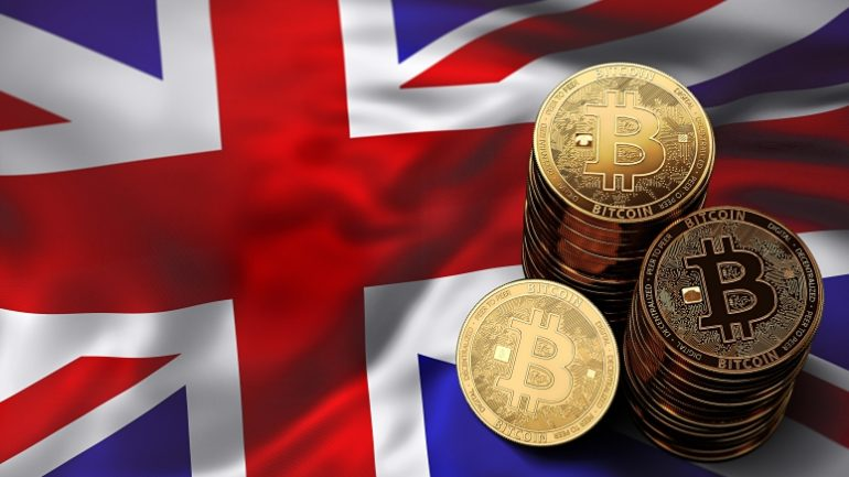 phisycal bitcoins stacked above uk flag