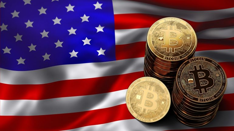 phisycal bitcoins stacked above usa flag