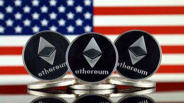 Physical version of Ethereum (ETH) and United States Flag