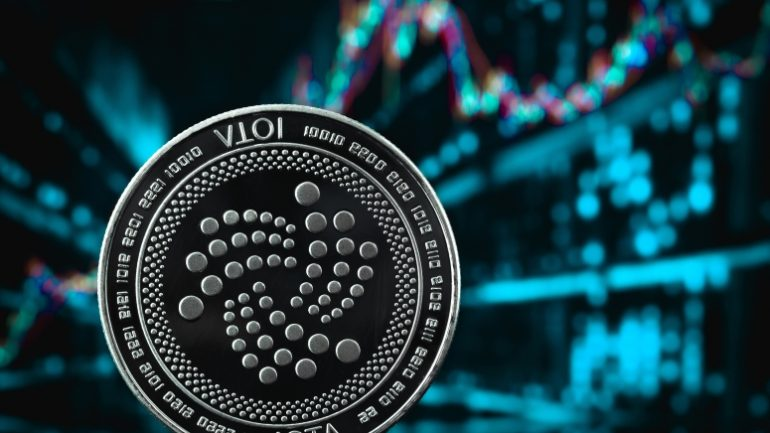 iota coin cryptocurrency on the chart background