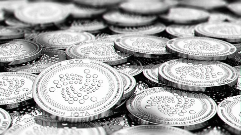 Stack of silver IOTA coins in blurry closeup with copy space above in blurred area. 3D rendering