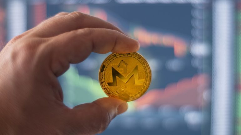 person keeping a golden monero (one of the easiest cryptocurrency to mine) in hand with a cryptocurrency exchange background, one of the l¡places where to buy monero