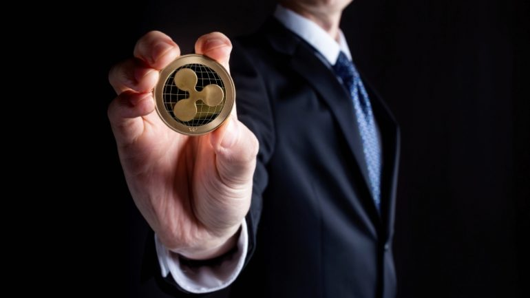 Ripple coin holded by a person