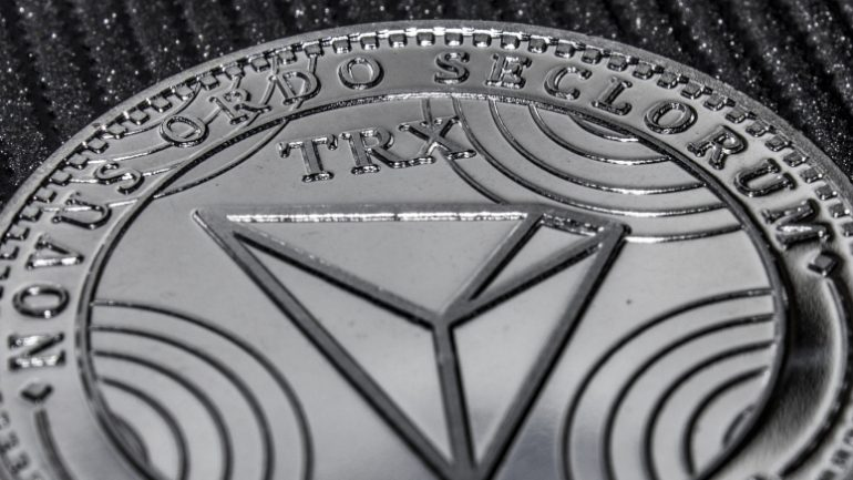 a fragment of the coin cryptocurrency tron closeup. TRX macro.