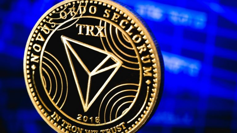 Tron coin labeled In Tron We Trust