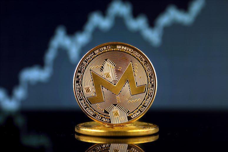 gyllene monero mynt
