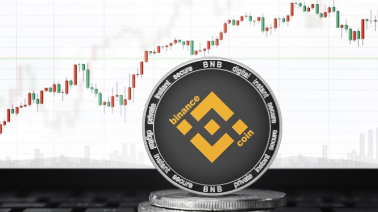 binance coin in front of trading graph