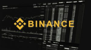 Binance exchange logo over data feeds