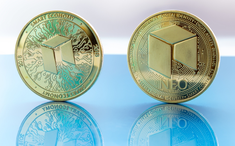 neo golden coin on glass