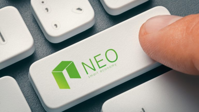 finger pressing computer key with neo coin logo