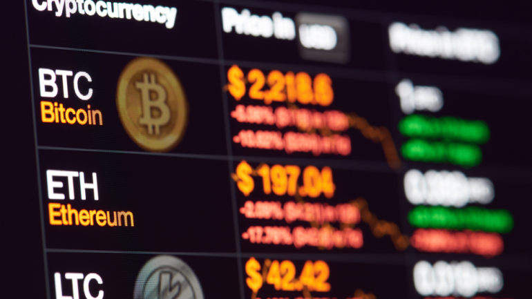 bitcoin ethereum and litecoin crypto prices displayed on a screen