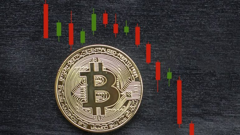 bitcoin with a decreasing graph on the back