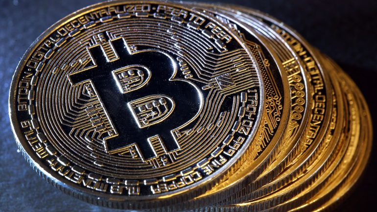 multiple bitcoins stacked one above each other