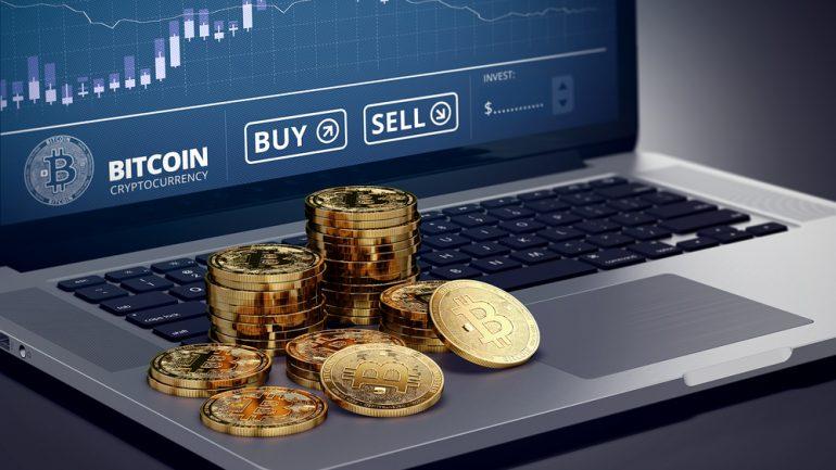 phisycal bitcoin on laptop