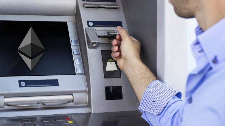 man withdrawing from ethereum atm