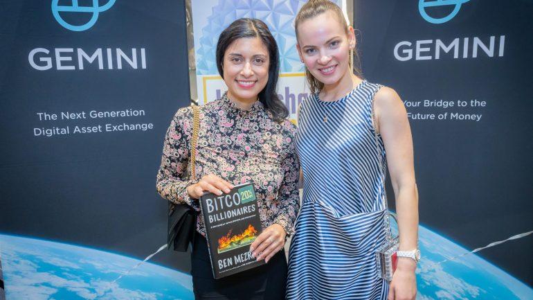 blockchainweekend two women in from of gemini banners