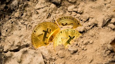 bitcoins buried in sand