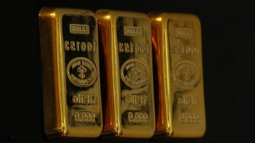 gold blocks illustrating gold-backed cryptocurrencies