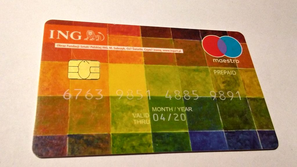 An ING Maestro Prepaid Card in a grey background
