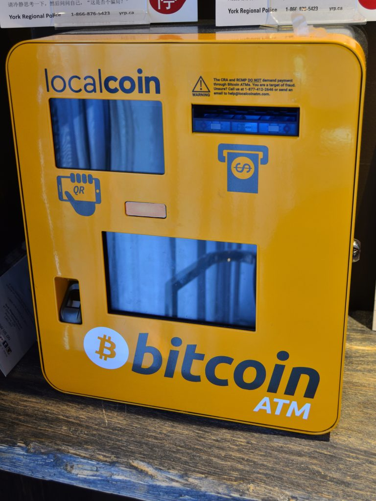 Orange Bitcoin ATM with the Bitcoin logo