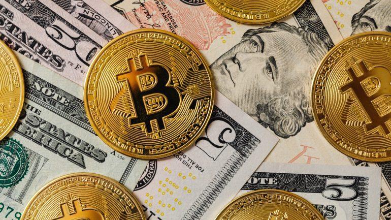 Bitcoin coins and Dollar banknotes
