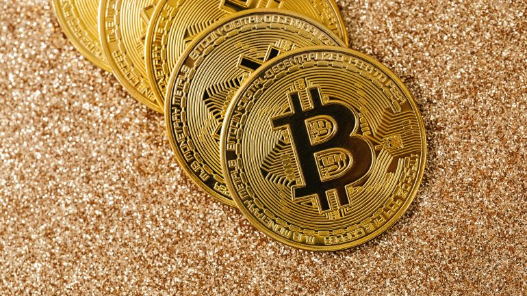 Bitcoin coins with sand background