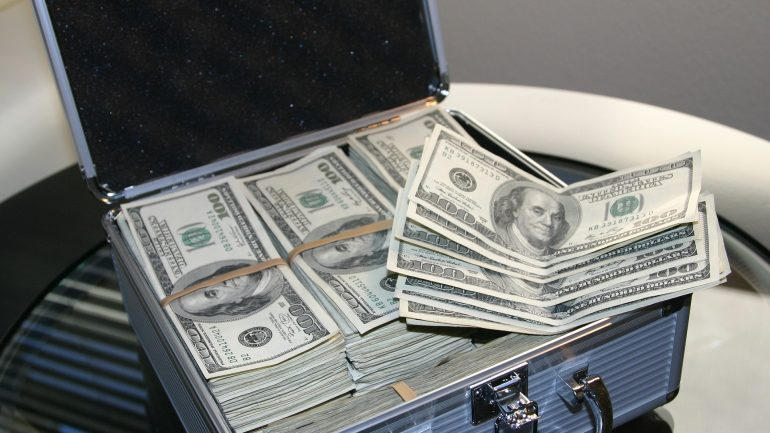 A box with U.S. Dollars investment funds